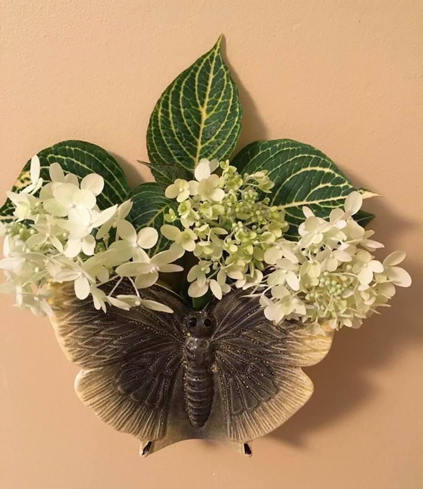 butterfly wall pocket full of hydrangea blooms