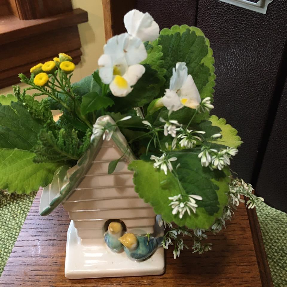unique vase full of flowers