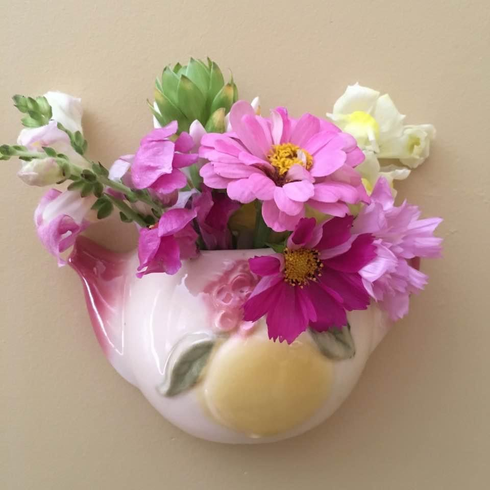 small wall pocket with pink and white flowers
