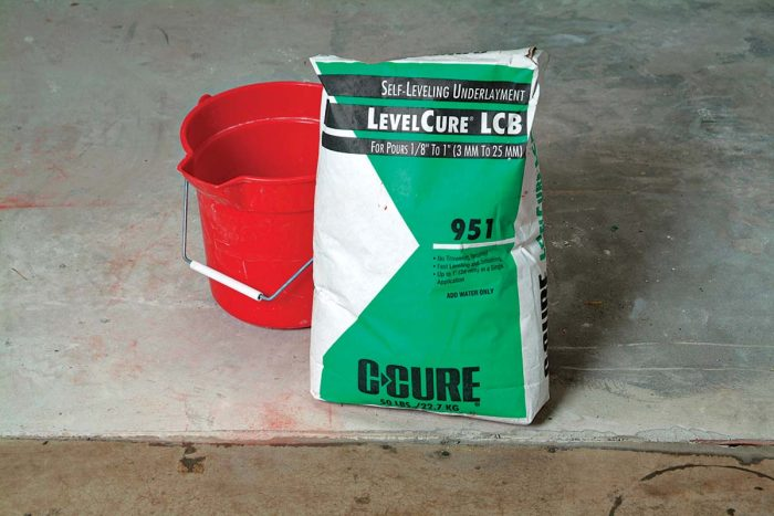 Self-leveling compound is mixed with water.