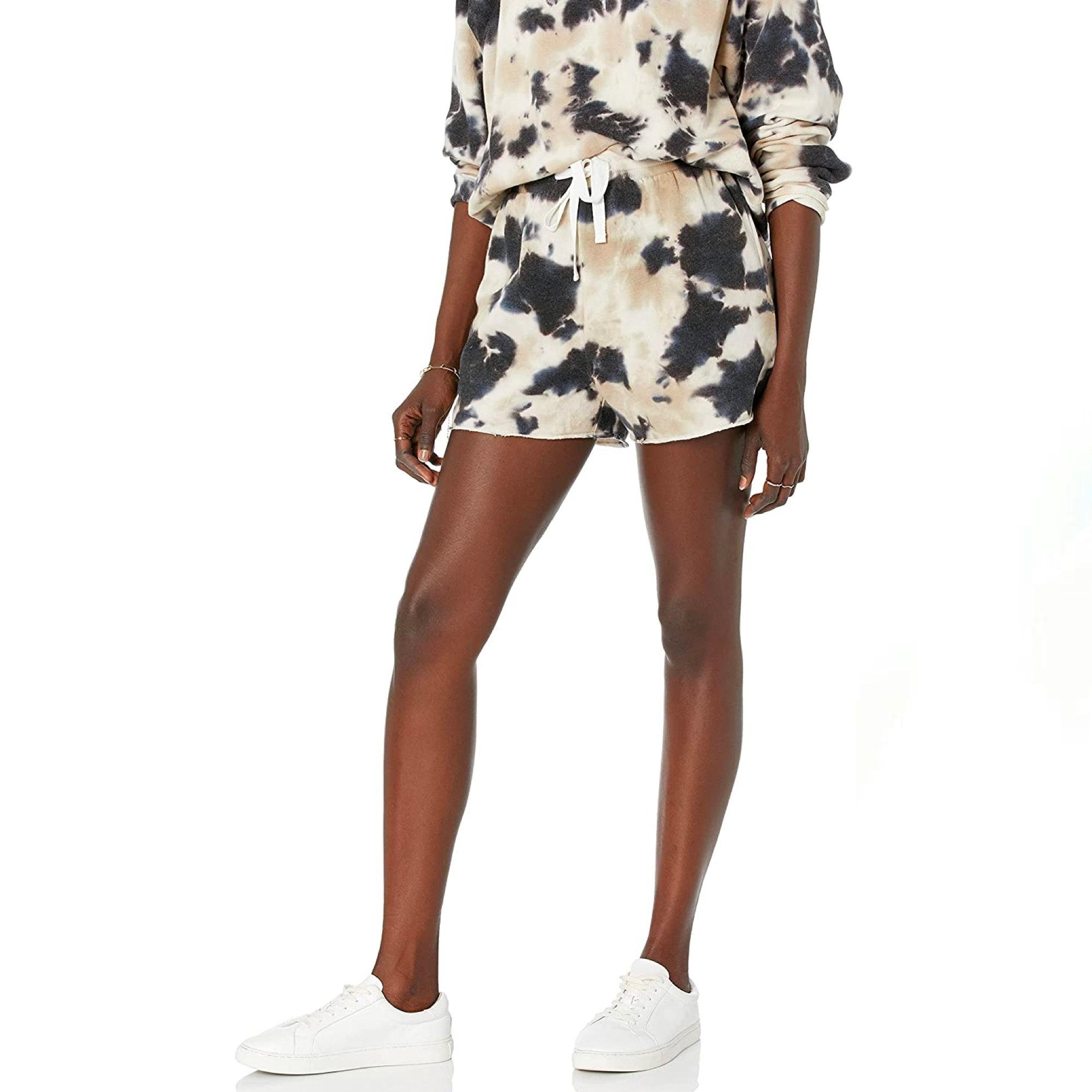 model wearing black and white tie dye shorts